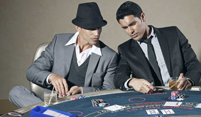 Post18 TwoMenPlayingPoker 695x405 - 2 Benefits of a More Lenient Gambling Law in NZ