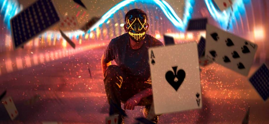 Post29 ManInMaskWithFallingCards 920x425 - 4 Classes of Gambling in New Zealand