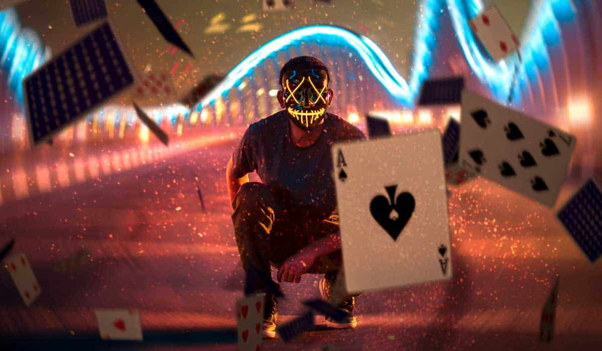 Post29 ManInMaskWithFallingCards - 4 Classes of Gambling in New Zealand